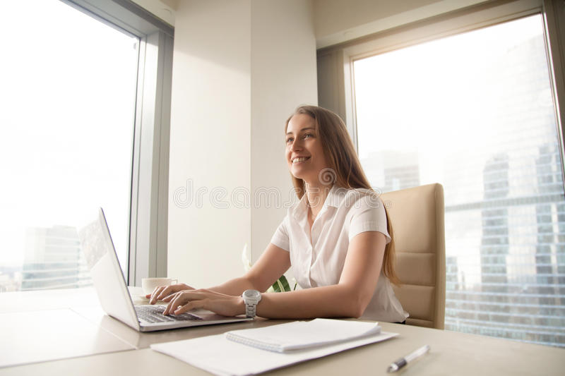 Young female entrepreneur feels happy at workplace royalty free stock images