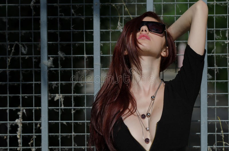 Young female fashion model with red hair and nice neckline royalty free stock images