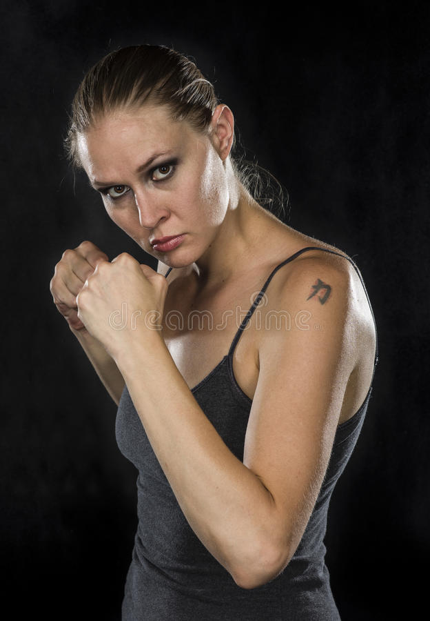 Free Young Female Fighter Looking Fierce At The Camera Stock Images - 59578174