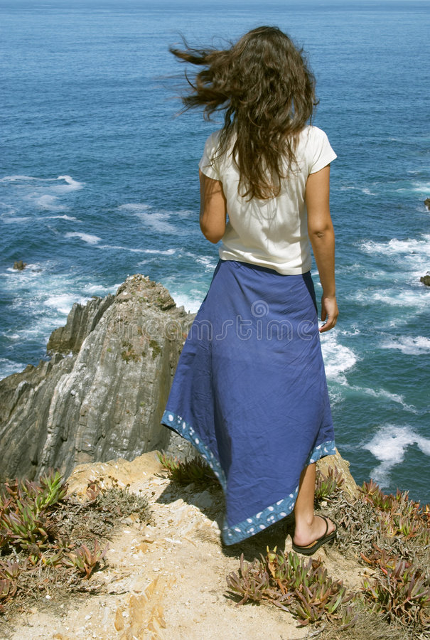Young female in front of ocean stock photos