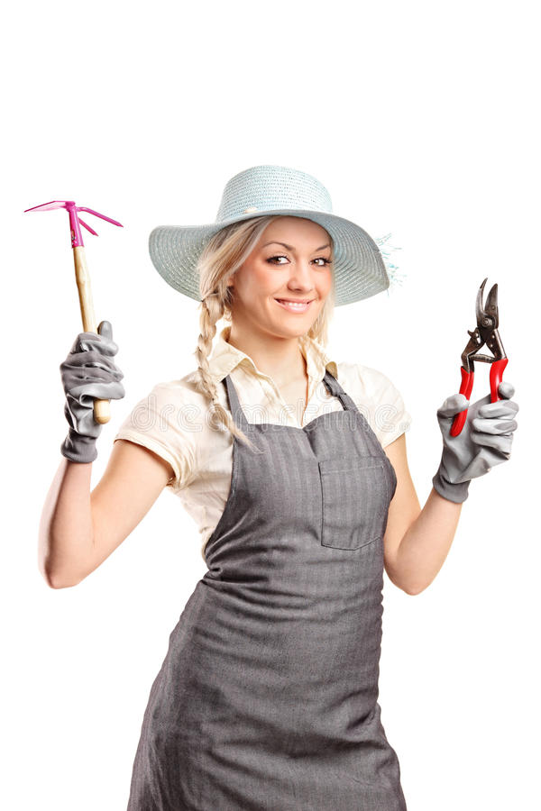 A Young Female Gardener With A Gardening Tools Stock Photo