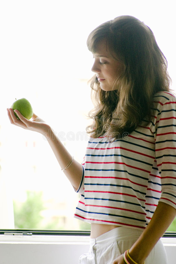 Young Female with Green Apple royalty free stock images