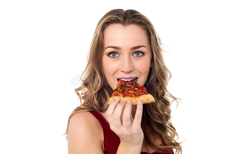 Young female having yummy pizza slice stock image