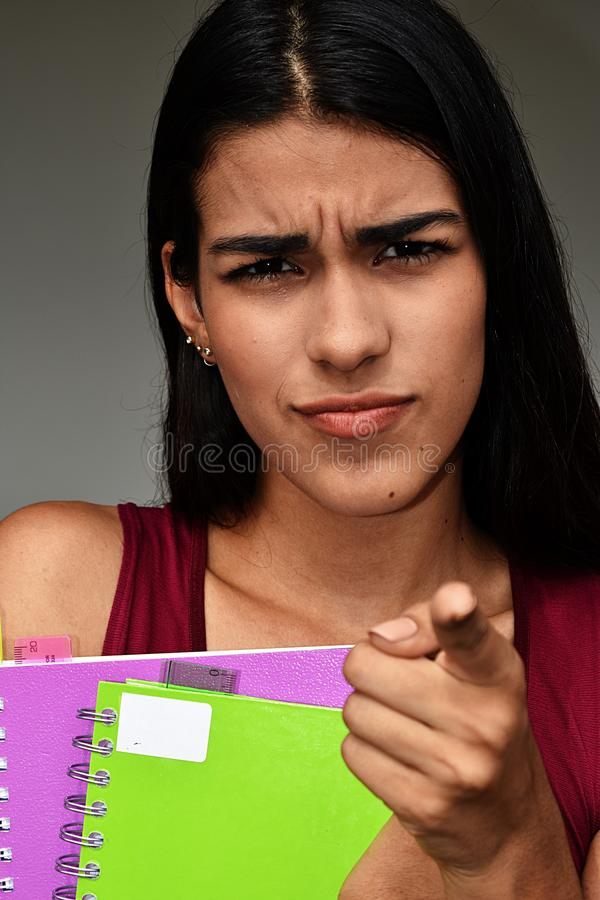 Mad Young Colombian Female Student. A young female hispanic teen royalty free stock images