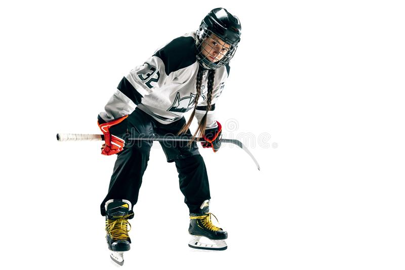 Young female hockey player with the stick isolated on white background stock images