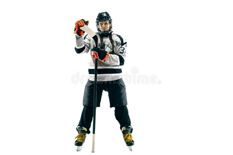 Young female hockey player with the stick isolated on white background royalty free stock images