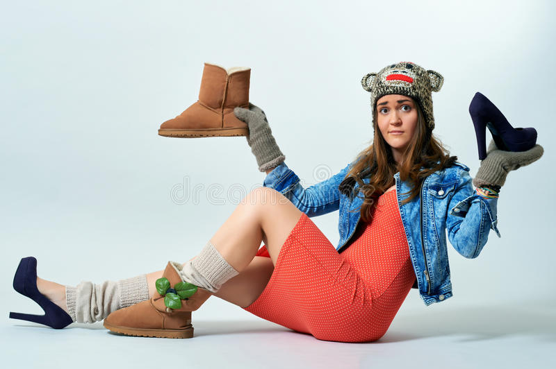 Young female holding a boot one hand royalty free stock photo
