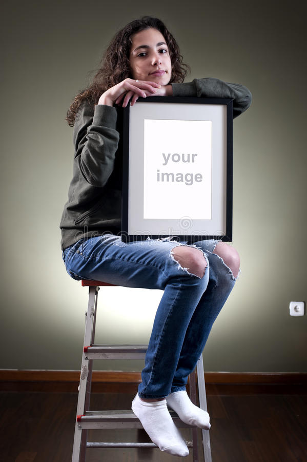 Young female holding picture frame royalty free stock images