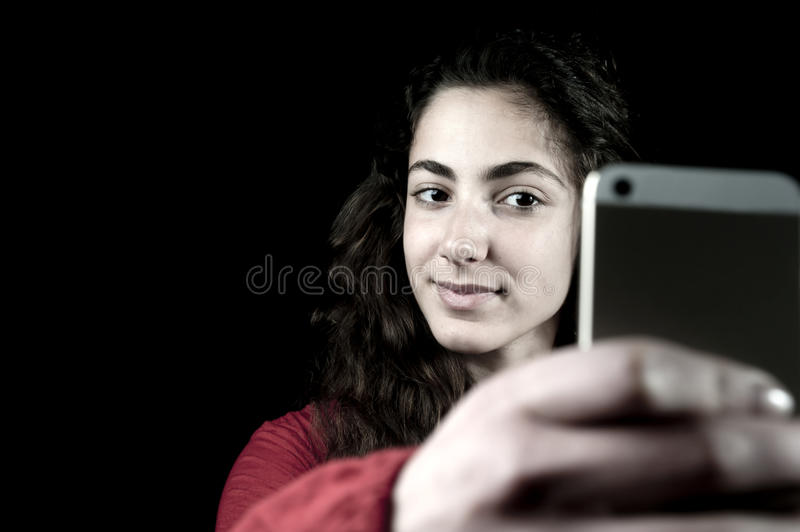 Young female holding a smartphone royalty free stock photo