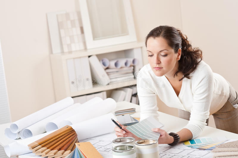 Young female interior designer working at office royalty free stock photos