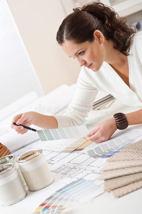 Young female interior designer working at office stock photography