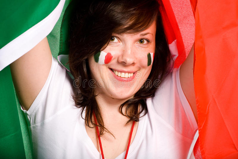 Young female with italian flag as background royalty free stock photos