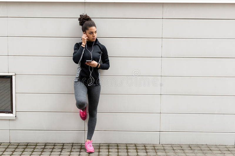 Young female jogger with earphones royalty free stock photography