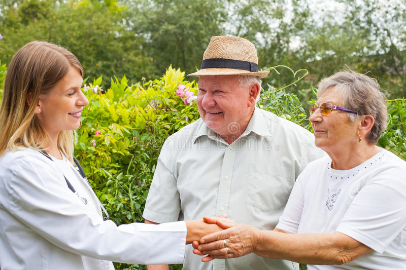 Medical doctor with elderly couple stock photo