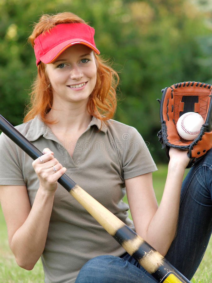 Young female with mitt, ball and bat. royalty free stock photography