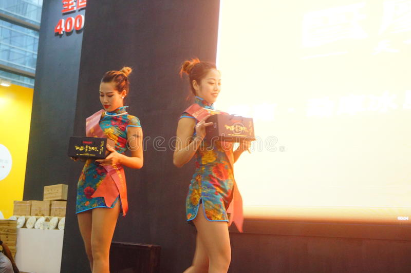 Young female models promote tea products. In Shenzhen tea industry expo, china stock images