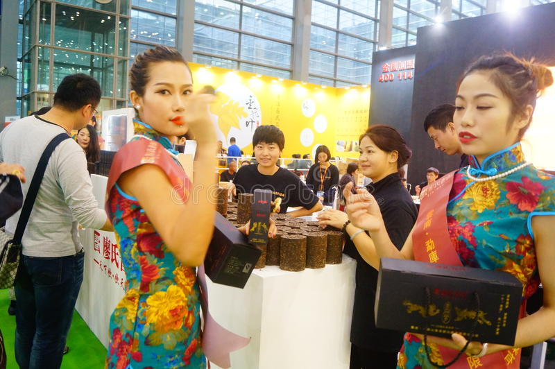 Young female models promote tea products. In Shenzhen tea industry expo, china stock image