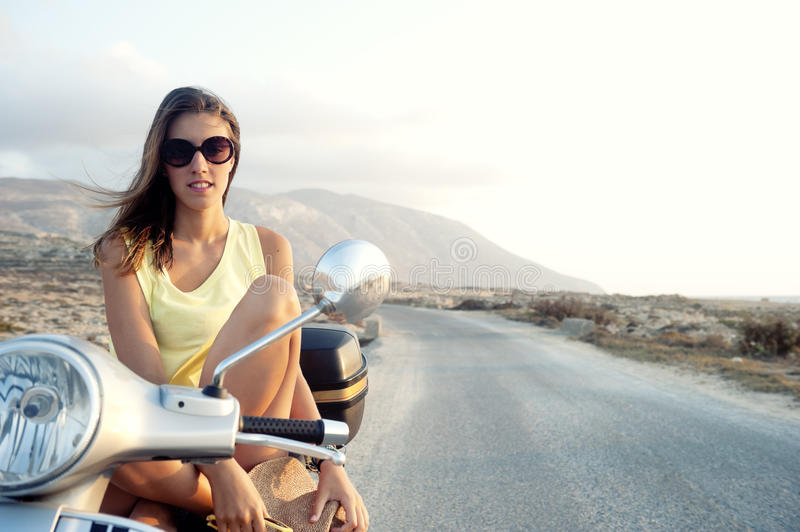 Young female on motorcycle trip stock photo