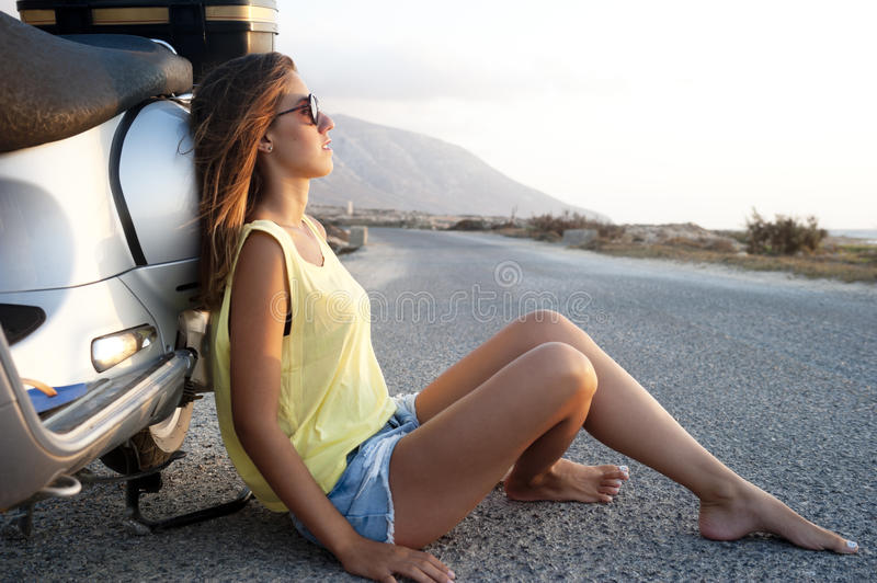 Young female on motorcycle trip stock photos