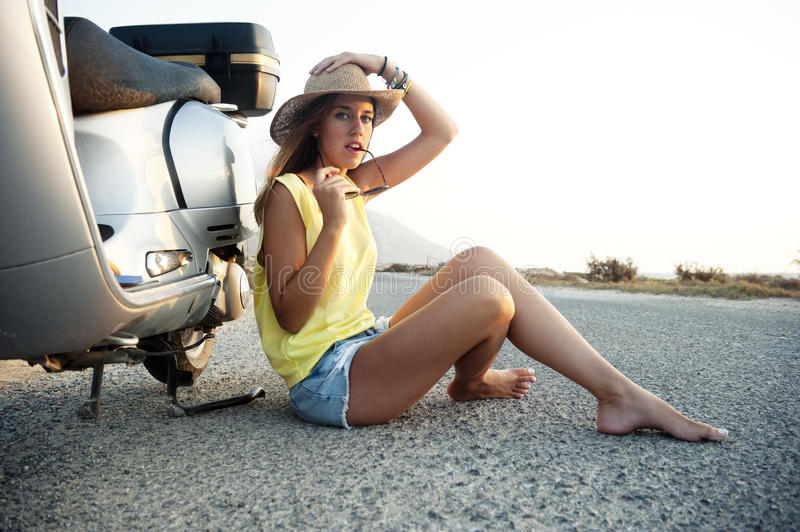Young female on motorcycle trip royalty free stock image