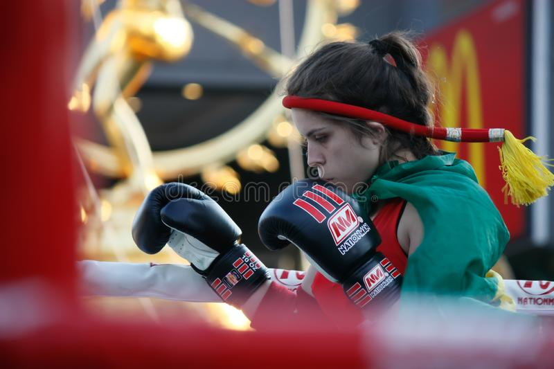 Young female Muay Thai boxing pay respect to the fight stock image