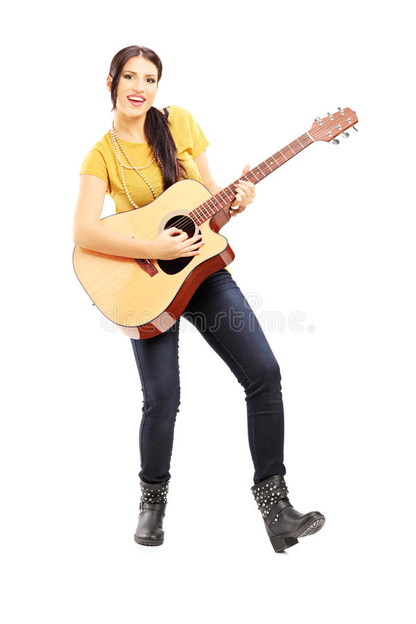 Young Female Musician Playing An Acoustic Guitar Stock Photography