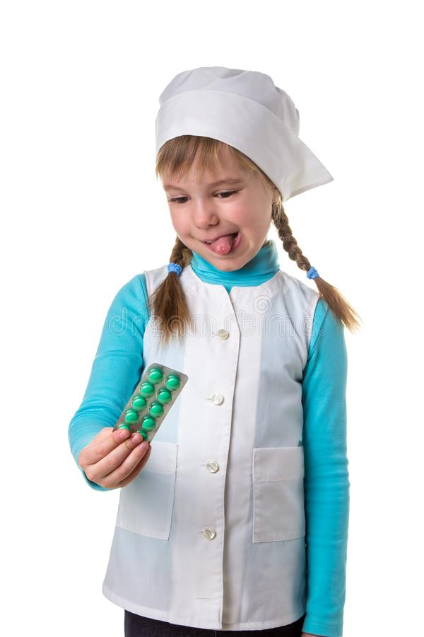 Young female nurse wearing medical uniform disgusted expression, emotion, holding blister of pills in the right hand.  royalty free stock photography