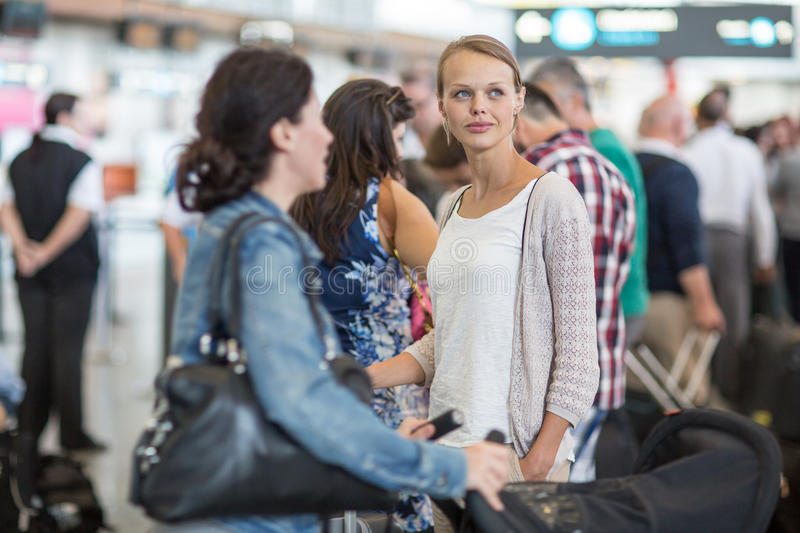 Young female passenger at the airport. About to check-in stock photography