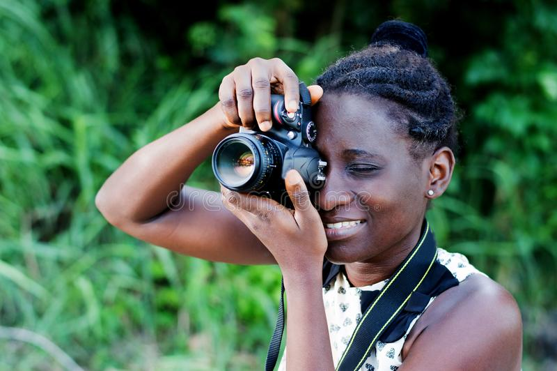 Young female photographer taking pictures. stock photo