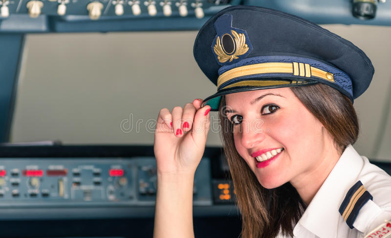 Young female Pilot ready for Takeoff. Young smiling female Pilot ready for Takeoff royalty free stock images