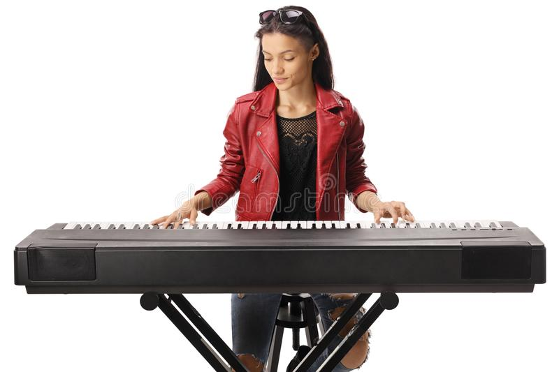 Young female playing a keyboard stock photos