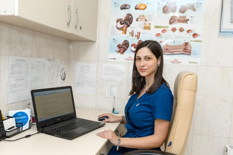 Young female professional medical doctor cardiologist in her office royalty free stock images