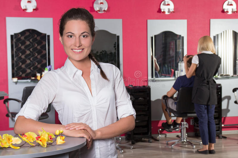 Young female receptionist of beauty salon. Young attractive female receptionist of beauty salon royalty free stock photo