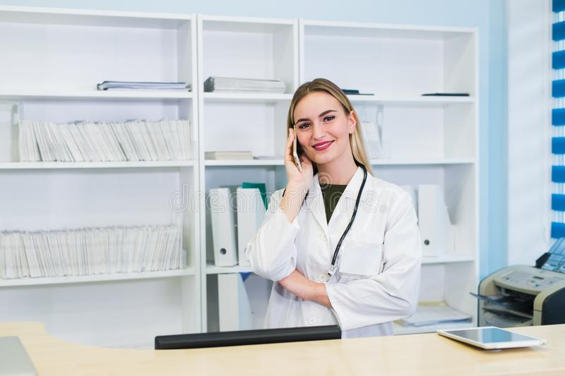 Young female receptionist talkingto the client patient in hospital stock photos
