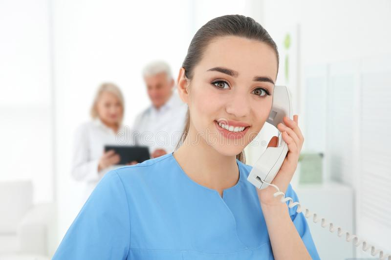 Young female receptionist working. In hospital royalty free stock images