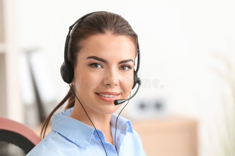 Young female receptionist stock image