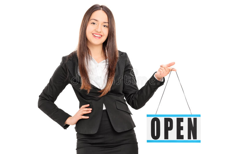 Young female retailer holding an open sign. Isolated on white background royalty free stock photo