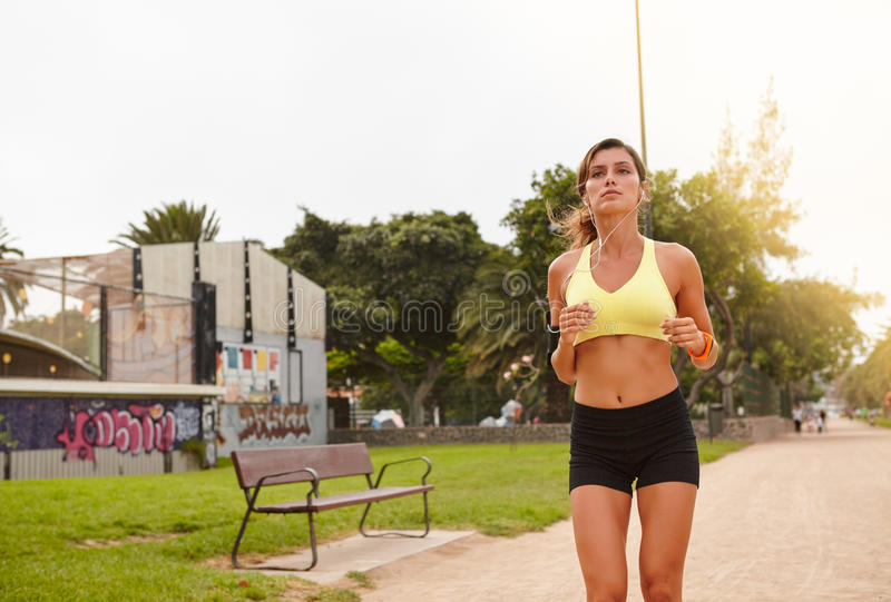 Young female running outside for healthy living royalty free stock photo