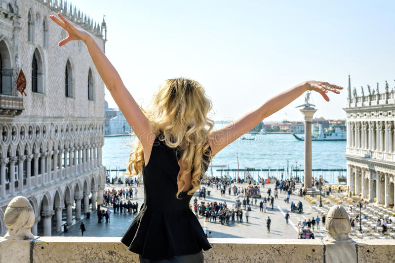 Young female at San Marco square in Venice. Back view royalty free stock image