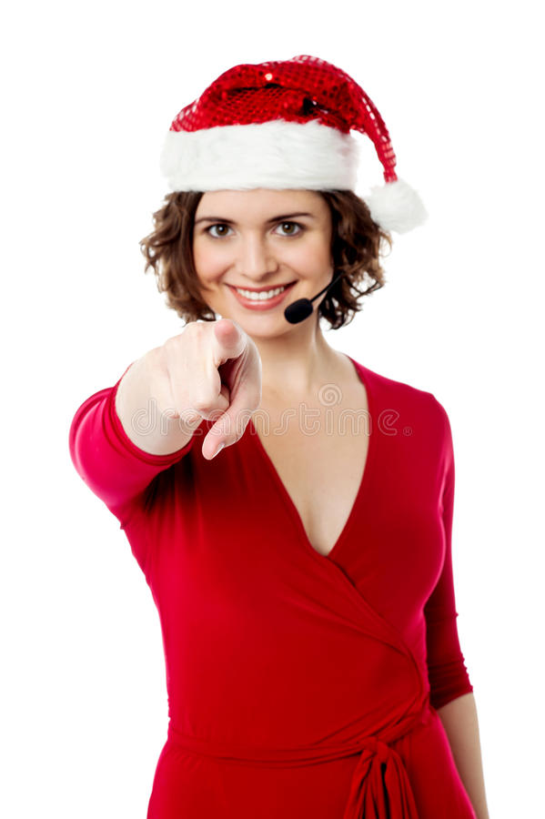 Young Female Santa Pointing Towards You Royalty Free Stock Photography