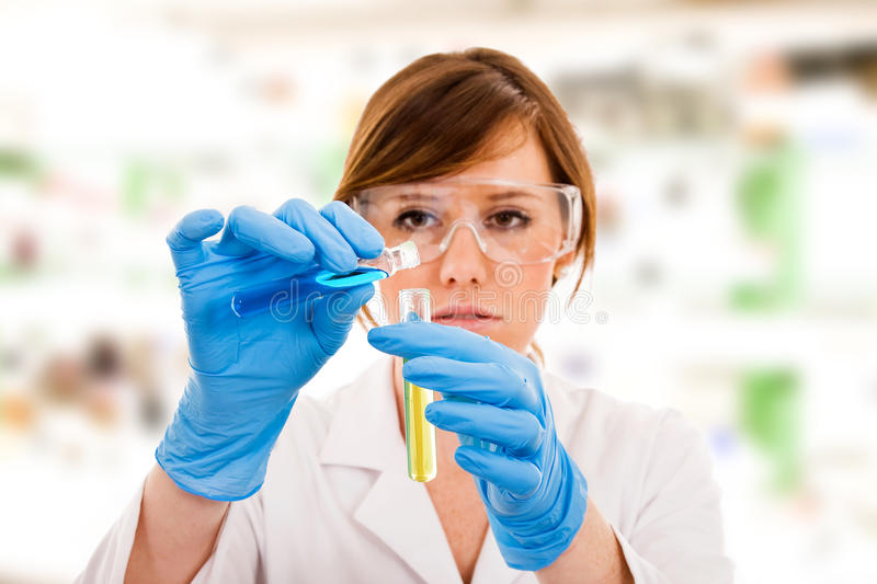 Young female scientist stock image