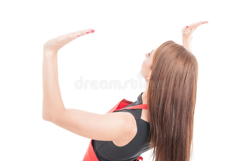Young female seller lifting something heavy stock photo