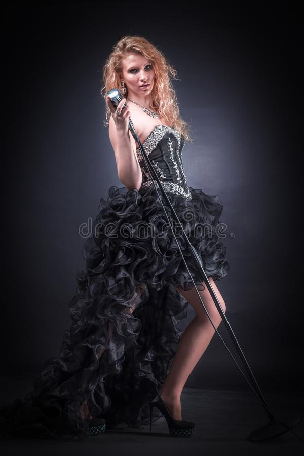 Young female singer performing a musical composition royalty free stock photo