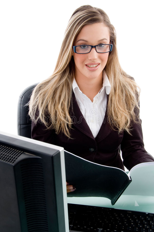 Young Female Sitting In Office Stock Image