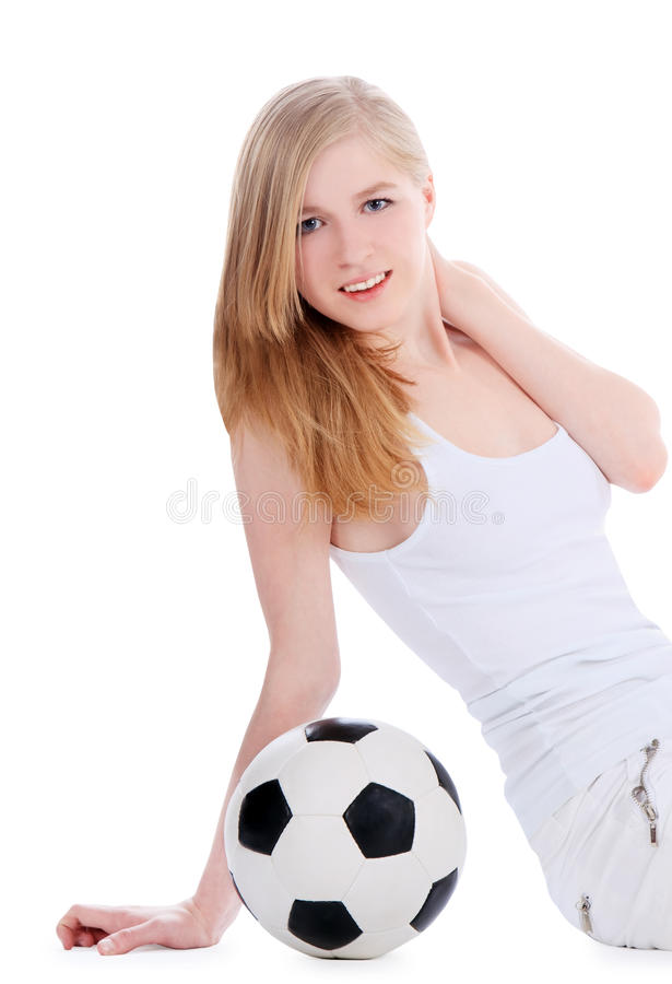 Young female sitting with soccer ball royalty free stock photography