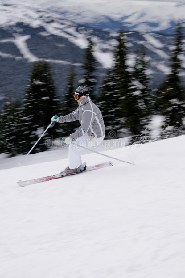 Download A Young Female Skier Enjoying Downhill Skiing In British Columbi Stock Photo - Image of outdoor, speed: 35342740