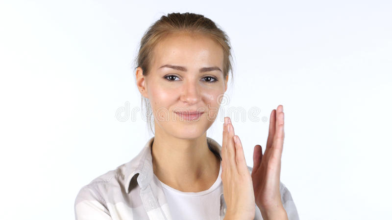 Young Female Student Clapping In Front Of White Background. High quality stock photography