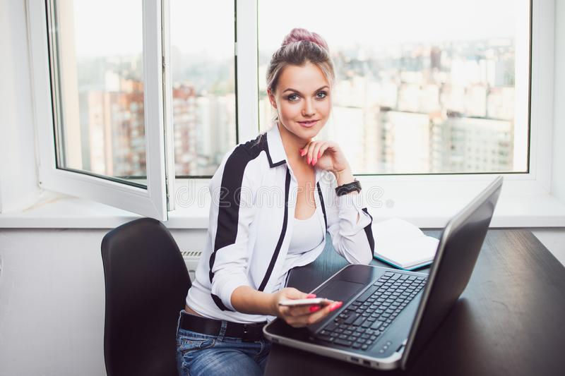 Young female student or entrepreneur working from home. Remote work royalty free stock photos