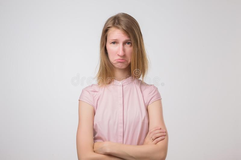 Young female student looks in bewilderment, being dissatisfied with something royalty free stock photos