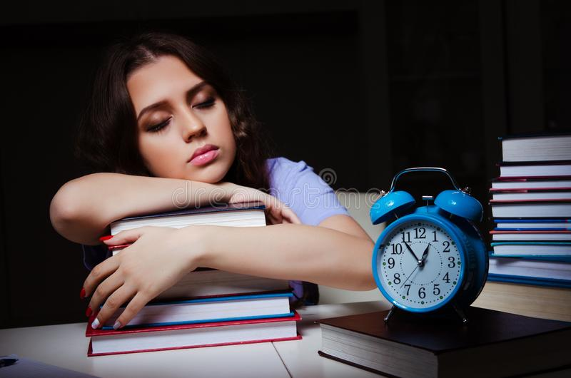 The young female student preparing for exams late at home. Young female student preparing for exams late at home stock image